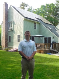 Tom Rummel, SolarFlair residential sales associate, is conducting the site evaluations for the discount Solarize Mass Bolton program. Behind him is an independent SolarFlair project the company installed on South Bolton Road.  Courtesy Barbara Parente