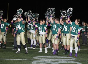 The purple accessories the Nashoba players were wearing at Friday night's game represent support for Pancreatic Cancer Awareness in honor of the passing of Cheryl Wood, mother of Nashoba students Sophie and Jack (who is on the football team), and wife of former Nashoba superintendent Michael Wood.                                                                                                                                           SusanShaye.com
